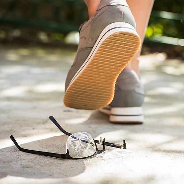 women stepping on glasses sidewalk